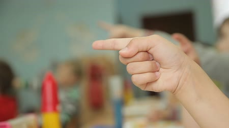 kciuk : Childrens hand points with fingers. The index finger of a child. Pointing hand gesture.