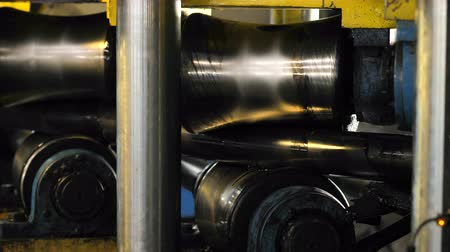 rozsdamentes : Tube Rolling Machine At The Factory. The machine aligns the metal pipe