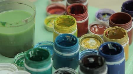 guache : Set of multi colors gouache on plastic jars. Rotation multicolor background. A lot of varicolored paint gouache jars.