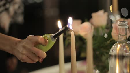 cera : The girl lights candles on candlesticks. Romantic evening. Romantic candlelight dinner. Vídeos