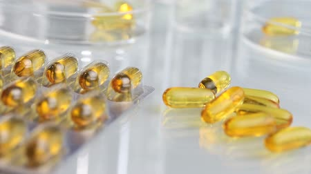 nutritional supplement : vitamins supplements pills omega 3 on table  isolated with blister