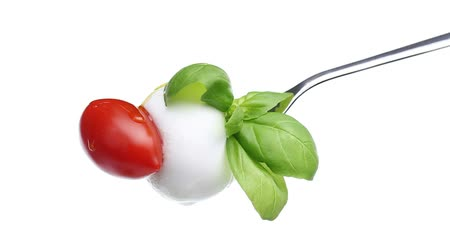 çatal : fork tomato basil mozzarella topped with spilled oil isolated on white background