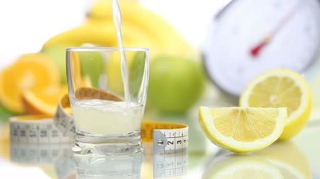 диета : lemon juice poured in glass, fruit meter scales diet food