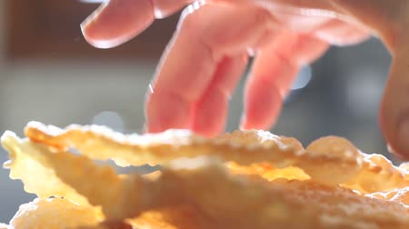 pastry : hands of pastry chef prepares the crostoli Stock Footage