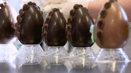easter : hands pastry decorating chocolate eggs easter Stock Footage