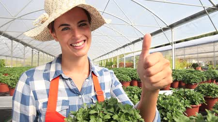 treatmen : smiling woman in greenhouse with like hand