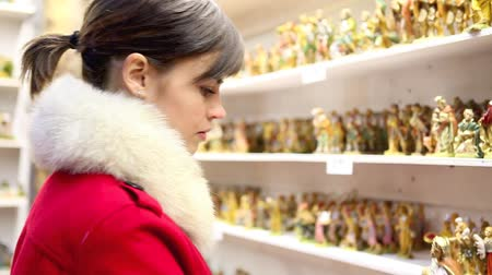 myrrh : christmas woman shopping in market store, magi statuette