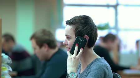 kontakt : Call Centre Agents Working in Their Bright Office Wideo