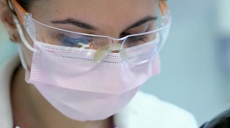 wiertarka : Attractive Doctor Dentist in Protective Glasses at Work