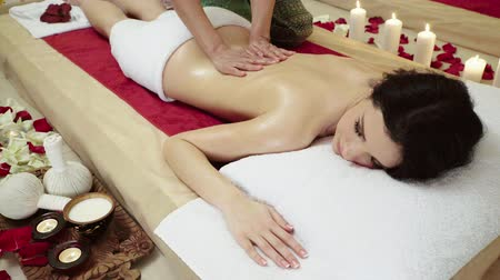 награда : Brunette Client Receiving upper body massage therapy at a luxury health at Spa Club Стоковые видеозаписи