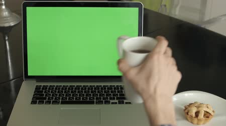érintőképernyő : A man types on a laptop on his desk.  Green screen for your custom screen content. Stock mozgókép