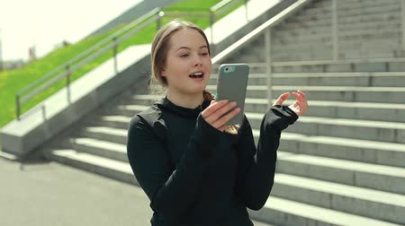 magány : Young Girl Using Smartphone Outside. Stock mozgókép