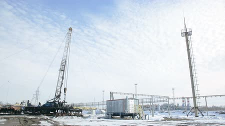 Repair of oil well. Facility with pipes or powerful process area at the oil depot or tank farm. Rock-oil for supply. Work at the engineering complex for refining. Worker outdoors in snowy winter