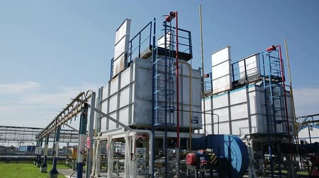 base station : Modern facility with pump or powerful process area at the oil depot or tank farm. Rock-oil extraction for supply. Engineering complex for refining and delivery. Dolly outdoors in sunny summer. Nobody