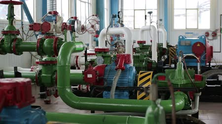 Improve gasoline in station with large number of pipes and valves. Testing center at oil depot or tank farm. Indoor powerful production area or facility. Distiller of crude. Well for gas extraction