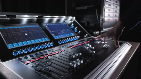 ajustando : Audio machine on table for working of sound designer or club dj at party in nightclub. Occupation for modern lifestyle and objects for listen at background. Musical player for tuning of stage close up