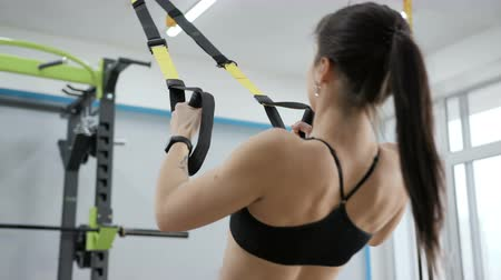pull out : Adult slender girl practicing athletic activity indoors slowmotion. One 20s person with beauty of life and vitality of recreation. Fit exercising with tracksuit for well being and energy close up Stock Footage