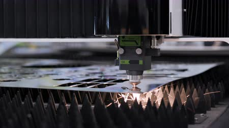 broca : Machining and cutting of metallic part closeup. Computer control of high tech manufacture of construction product. Accuracy of iron working and heat processing. Hot flame from motion of ray or beam