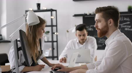 Trendy diverse confident partners start up finance report occupation. Sale idea on digital screen. Beautiful male caucasian employee or hipster person sitting at table in bright loft space closeup
