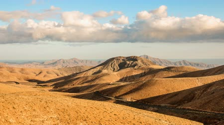 wideangle : Timelapse clouds flying over mountains dry and smooth hills, Fuerteventura, Spain