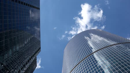 glass structure : Sky and clouds reflections timelapse on corporate buildings at a summer day.