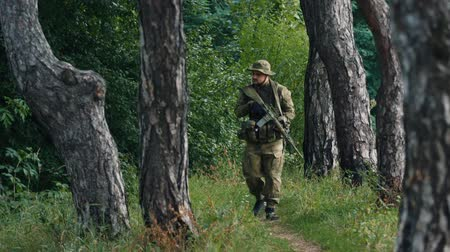 asker : Armed men walking the woods. Airsoft game