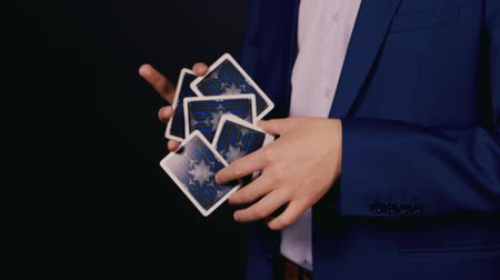 маг : Hands magician show a trick with cards