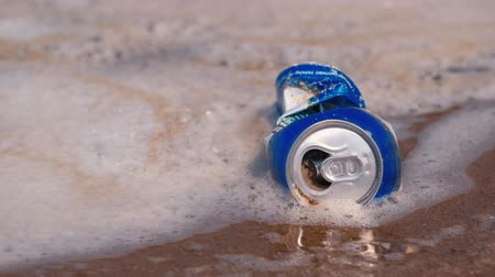 drink cans : An empty beer can in the dirty water Stock Footage