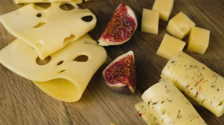 parmigiano : A set of different cheeses with figs, turns to the camera Stock Footage