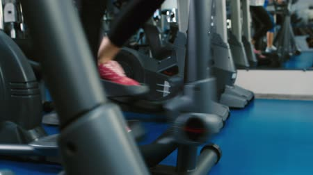 elliptical : Training in the gym on the elliptical trainer feet