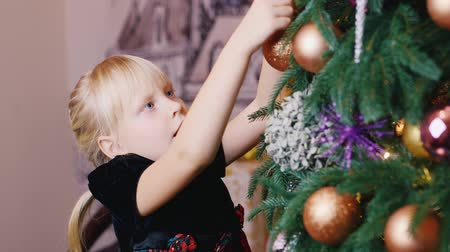 little : Blonde girl dress up Christmas tree