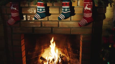 holidays : Above the fireplace hangs a burning socks for gifts for Christmas