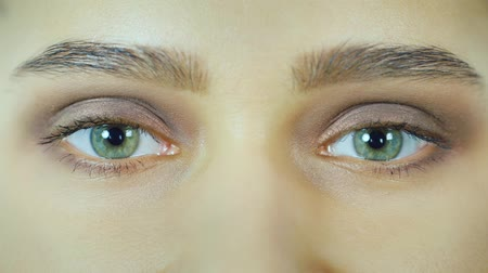 looking : Green female eyes looking at the camera Stock Footage