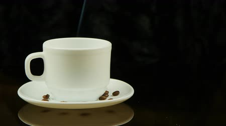 coffe : A cup of hot coffee on a black background