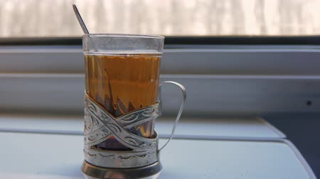 çay fincanı : A glass of tea at the a train window
