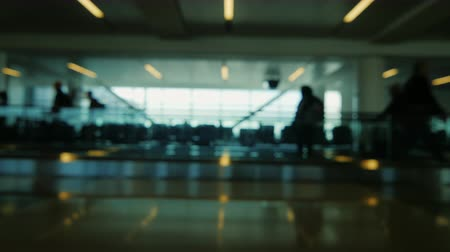 corporate : Blurry video - background Airport terminal, passengers are on your flight Stock Footage