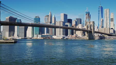 nyc : The famous Brooklyn Bridge in New York, USA. Clear autumn day, morning Stock Footage