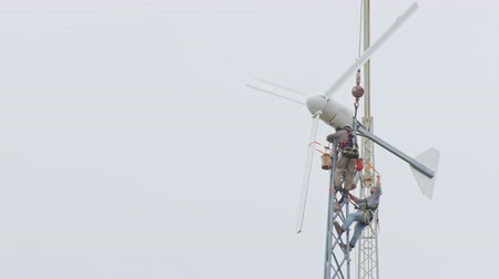 turbine : Dangerous profession. Two men working at high altitude. are repaired wind turbine Stock Footage