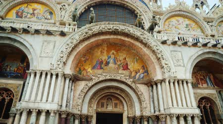 marcos : Venice, Italy, June 2017: Facade of the Church of St. Mark in Venice. Beautiful framing and famous horses on the roof
