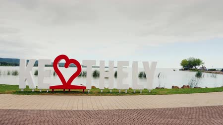 subtítulo : Keszthely, Hungury, June 2017: I love Keszthely. An inscription with a red heart. Popular resort of Hungary. Steadicam shot Stock Footage