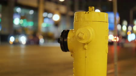 greater : Yellow fire hydrant. Toronto, evening, lights and car lights shine Stock Footage