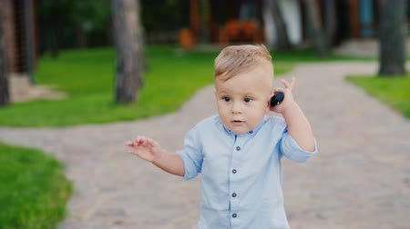 goes : Funny 1 year old kid plays with the keys to the car. Speaks as on the phone as a small businessman. Funny video with children