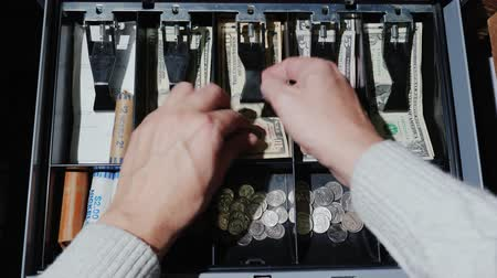 drawer : The cashier puts the money in the cash register and takes the change. Retail for cash US dollars Stock Footage