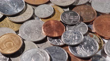 enflasyon : Coins of different countries and different periods. Background with money Stok Video