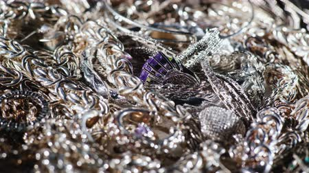 jewellery : A lot of silver jewelry. Background of silver. 4K 10 bit video