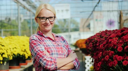 margarida : Housewife of small business. Portrait of a woman in a plant nursery