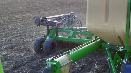 sow : Spring work in the field is the sowing of cereals. Part of a modern sowing machine