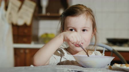 barszcz : Sweet girl 5 years eating soup in the kitchen