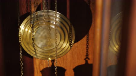 antiquities : The pendulum of old antique watches and chains with weights