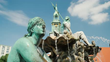 bronz : Statue of a woman on the fountain of Neptune in Berlin